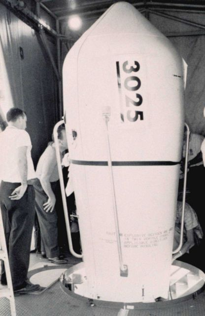 Securing cover for TIROS V satellite prior to launching Picture