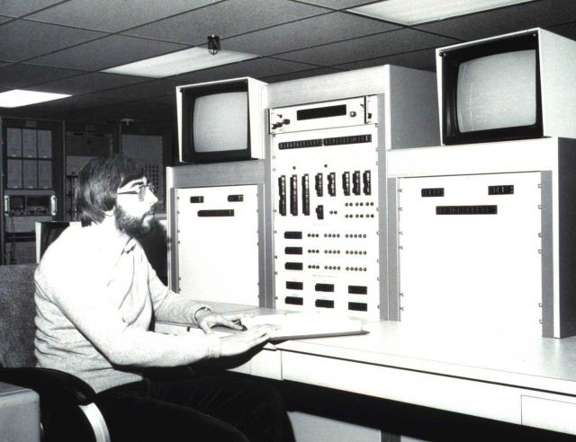 Satellite Operations Control Center (SOCC) Controller James Budd at TIROS-N Controller's console, from which two operational TIROS-N type spacecraft a Picture