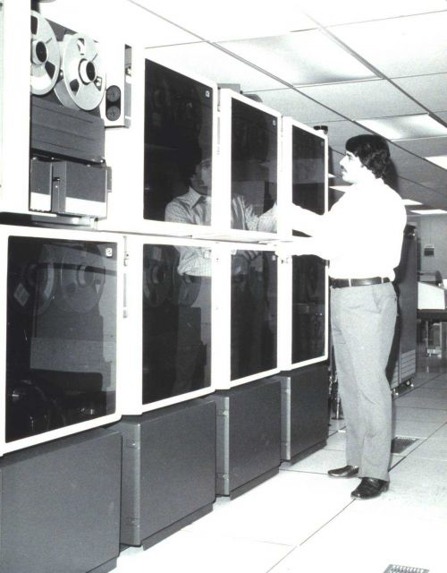 Scientist Frank Porto at the tape drives of the then new National Environmental Satellite Service (NESS) mass data storage system, the SDC TBMII Picture
