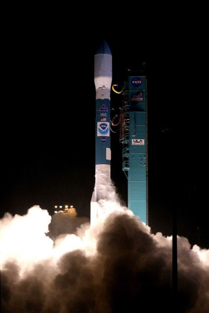 NOAA-N satellite leaps away from the smoke and steam clouds as it lifts off at 6:22 A.M Picture