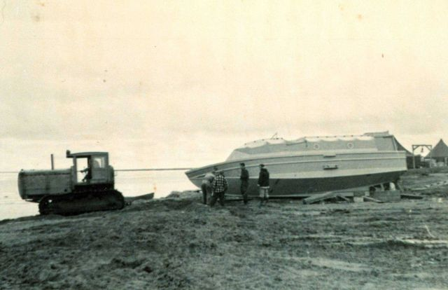 Launching survey boat with D-8 caterpillar at Nevat Camp Picture