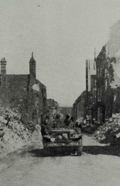 Survey party entering Vire, France, shortly after D-Day Picture