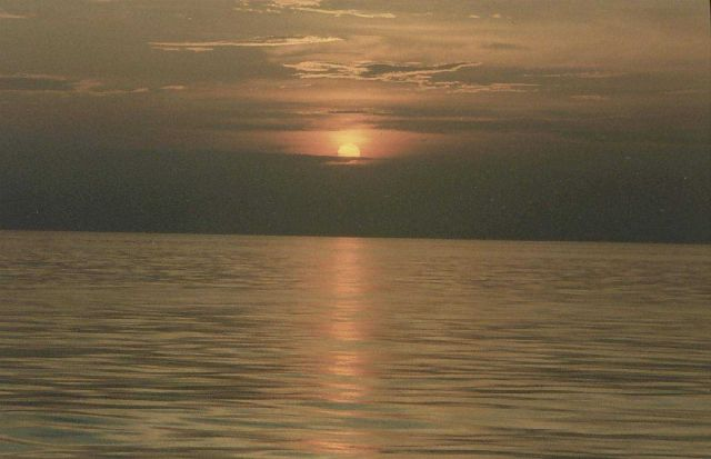 Sunset on a calm sea. Picture