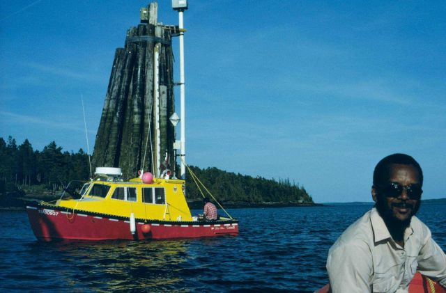 Canadian Hydrographic Service launch at dolphin tending tide gauge Picture