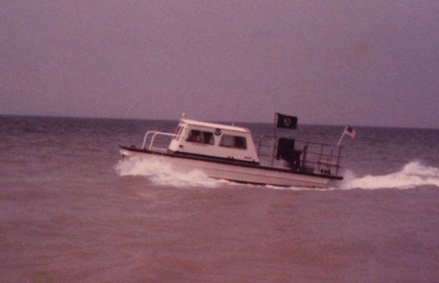 Inshore survey boat running a line. Picture