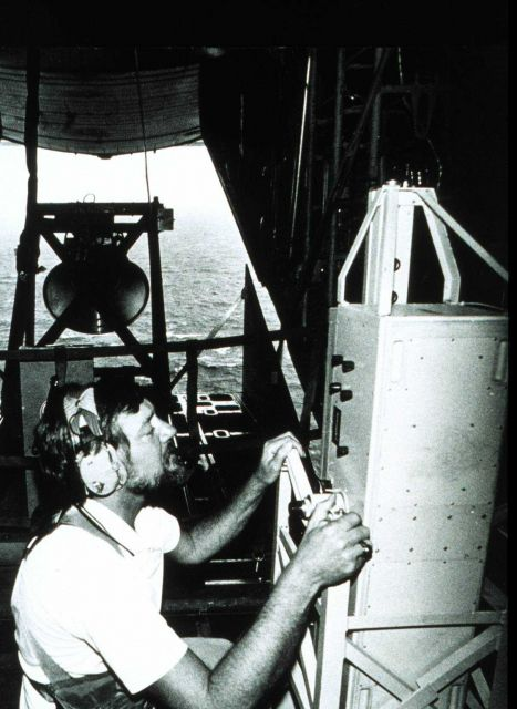 Cargo door of C-130 open while Robert Berles adjusts down-pointing laser Laser measuring wave height directly below NOAA C-130 aircraft Measurements t Picture