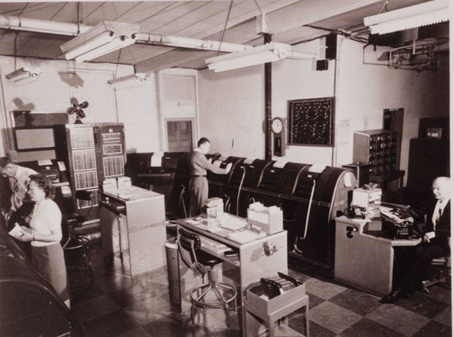 Teletypewriters in action; transmitting and receiving weather data from the U.S. Picture
