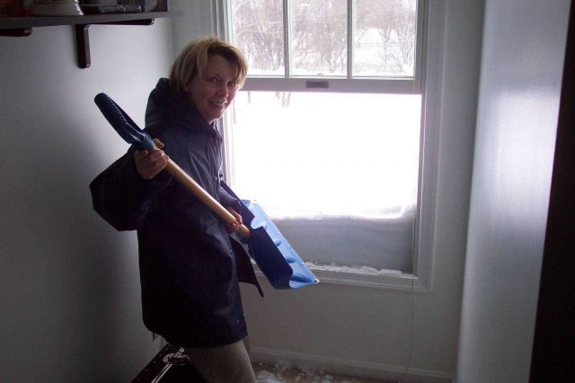 Shoveling off the roof from a second floor bedroom window. Picture