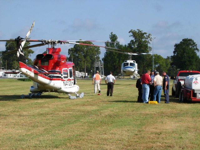 NOAA 61 working with contractor helicopters out of a makeshift heliport north of Baton Rouge Picture