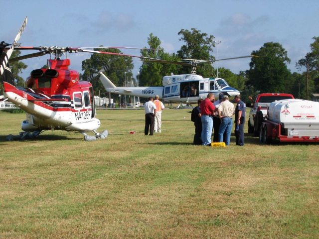 NOAA 61 working with contractor helicopters out of a makeshift heliport north of Baton Rouge. Picture