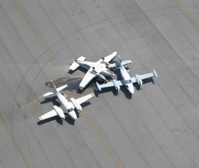 Aircraft blown around with one flipped over at Lakefront Airport. Picture