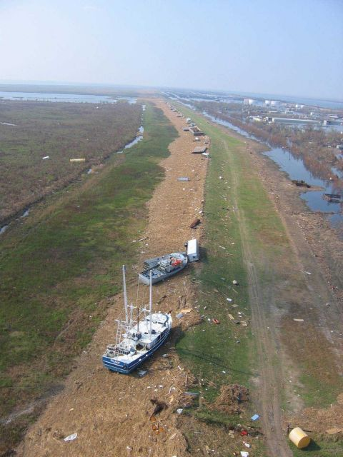 Boats, barges and debris on the levee at Venice. Picture