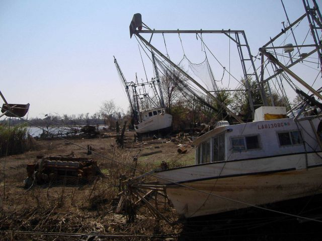 Shrimp boats on the shore following Katrina. Picture