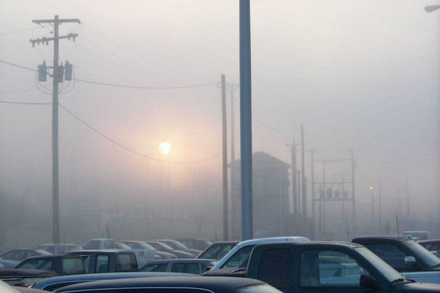 Sun rising as seen through the fog at the MARC train commuter lot at Point of Rocks. Picture