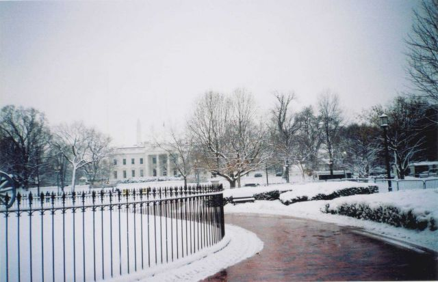 The White House draped in newly fallen snow with the Washington Monument barely visible in the background. Picture