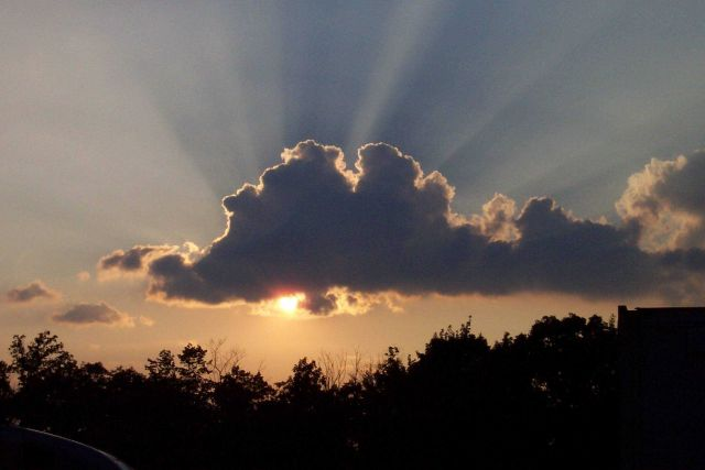 A sunset with shadow bands. Picture