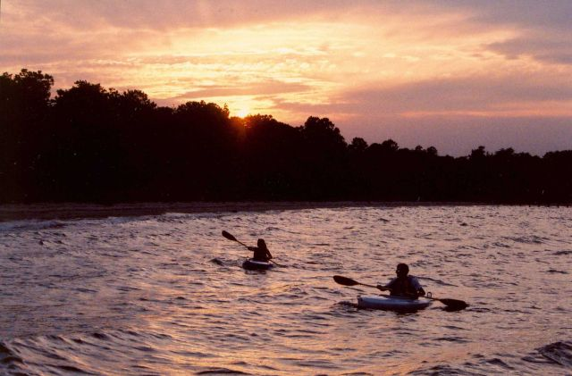 Kayakers enjoying a warm summer sunset. Picture