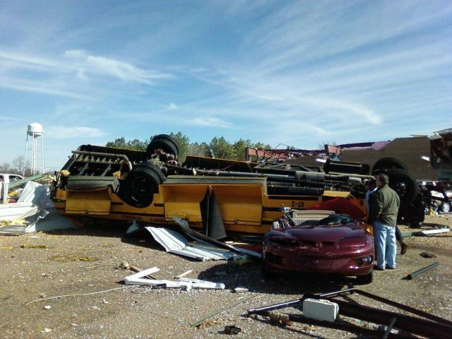 School bus flipped and crushed by tornado Picture
