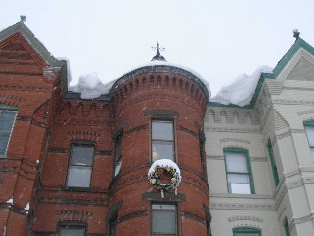 Overhanging snow from roofs of row houses following second major snowstorm of 2009/2010 season. Picture