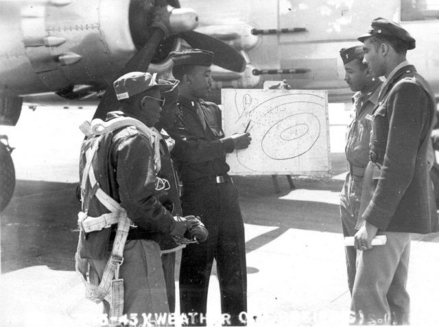 Briefing a Tuskegee Airman. Picture
