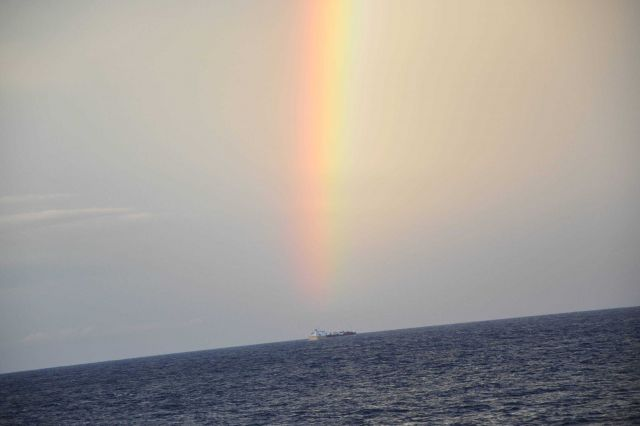 Rainbow over a small cargo ship Picture