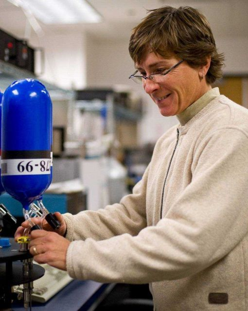 NOAA's Patricia Lang prepares to measure methane levels inside a flask that is part of NOAA's global air sampling network Picture
