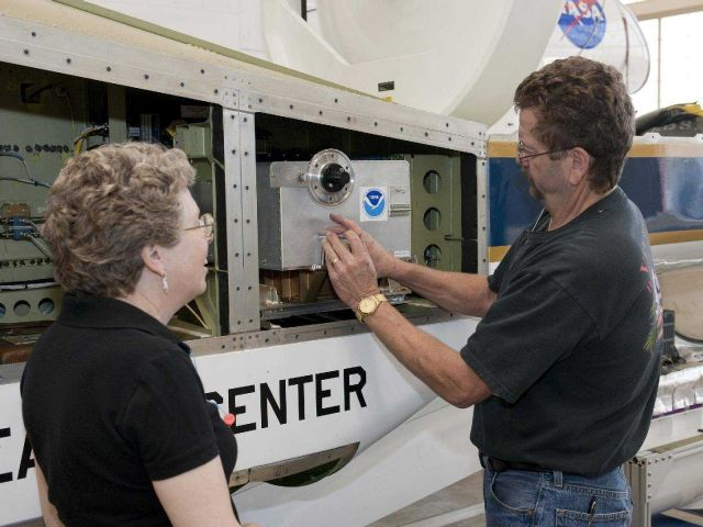 NOAA's laurel Watts and NASA Dryden's Dennis Pitts install NOAA's Ozone instrument on NASA's Global Hawk. Picture