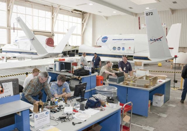 Atmospheric scientists check out their instruments in a hangar at NASA Dryden Flight Research Center prior to installation aboard one of NASA's two Gl Picture
