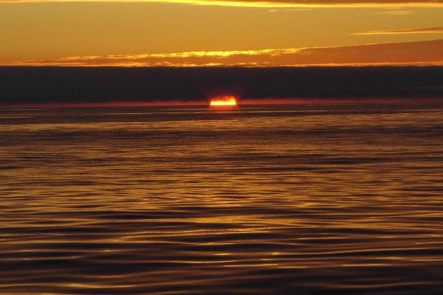 A golden sunset at sea. Picture