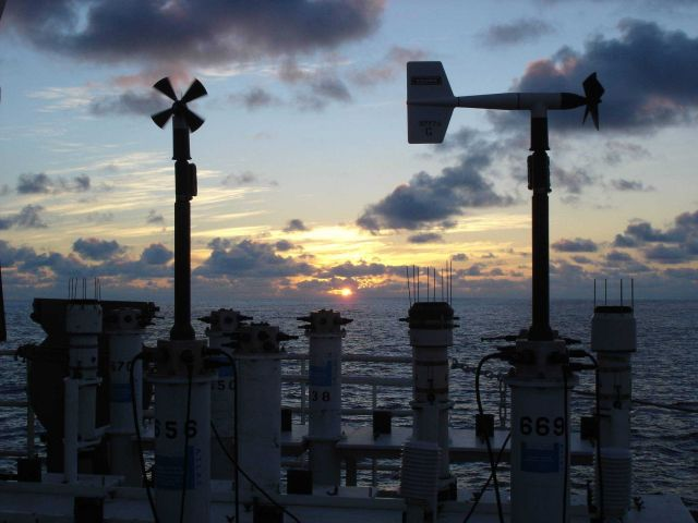 Sunset at sea seen over buoy weather sensors. Picture