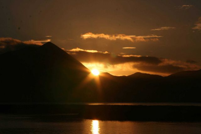 A bronze and gold sunset over Kodiak Island. Picture