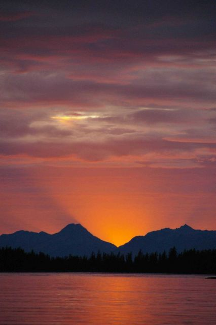 A golden Alaskan sunset seen from a quiet cove. Picture