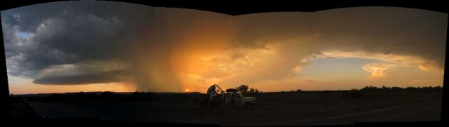 Composite photo of rain shaft in a setting sun. Picture