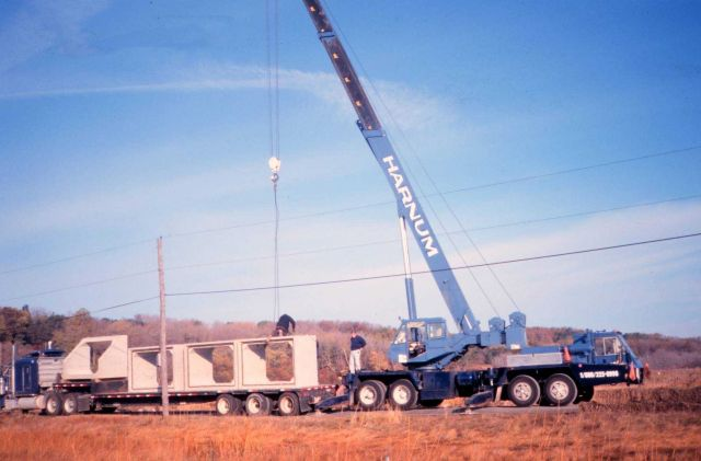 Culvert parts en route to the site arrive as the crane offloads various sections of the culvert off the flatbed. Picture