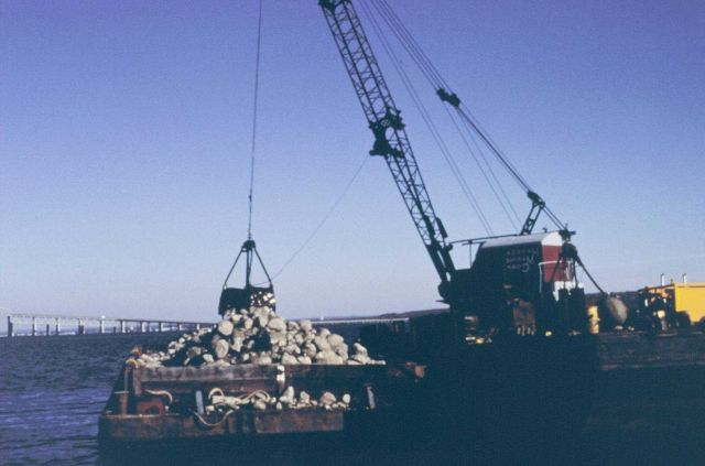 The crane and barge used to construct the cobble reef Picture