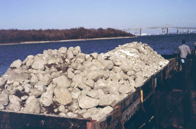 The barge with reef construction materials on board. Picture