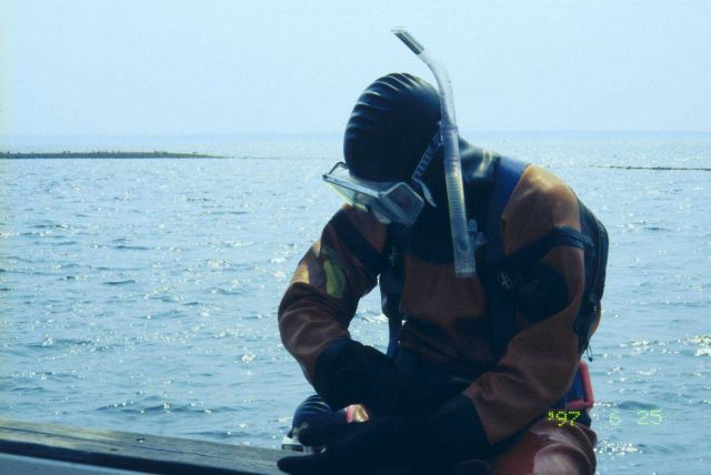 The second in a series of images showing NOAA scientists at the 1997 transplant site just before transplanting the eelgrass turf. Picture