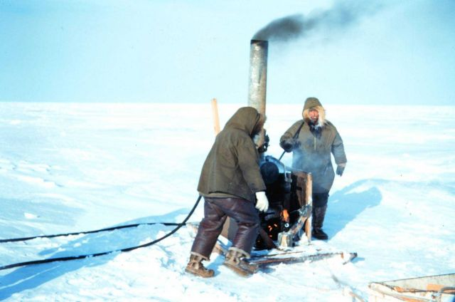 Using a boiler to melt the permafrost for setting a triangulation marker Picture
