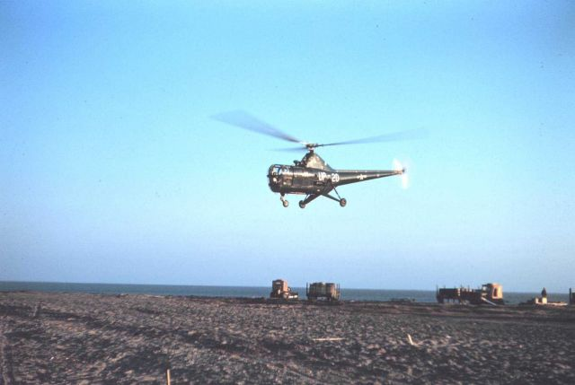 A Navy helicopter helping transport supplies Picture
