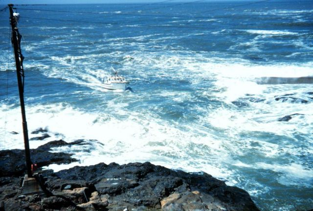 A small boat heading into Depoe Bay Picture