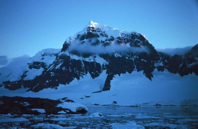 Mountain peak illuminated by midnight sun at Port Lockroy Picture