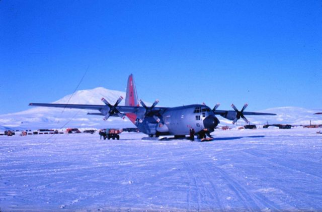 A view of Mount Erebus and the C-130 that flew scientific party from New Zealand Picture
