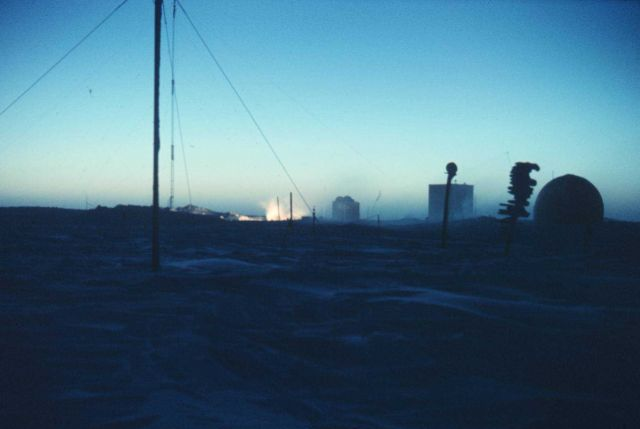 The first sunrays illuminating the generator exhaust at South Pole Station Picture