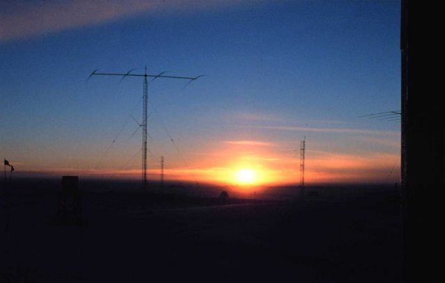 South Pole Station antenna farm illuminated by setting sun Picture