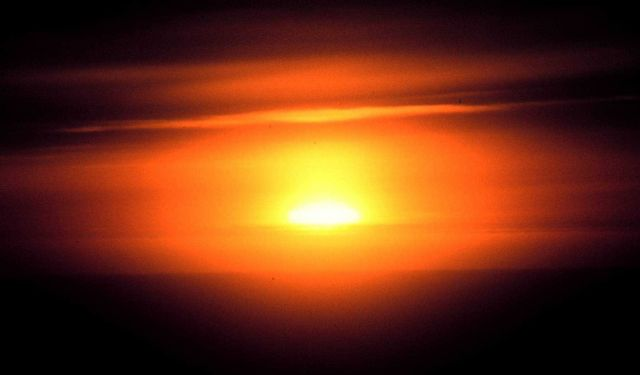 Haze and clouds obscure the setting sun Picture