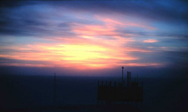 Instruments on the Clean Air Facility silhouetted against the sunset Picture