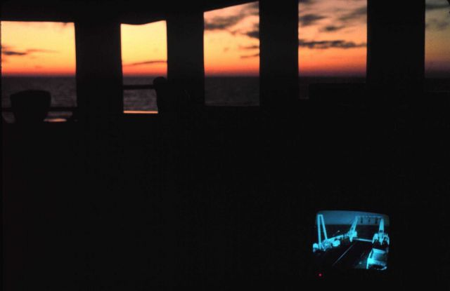 The bridge of the ALBATROSS IV at sunset - television is monitoring stern operations. Picture