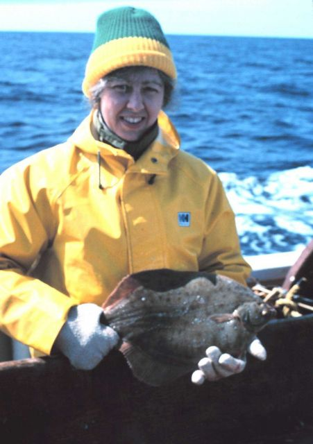 Fisheries scientist with a flounder. Picture