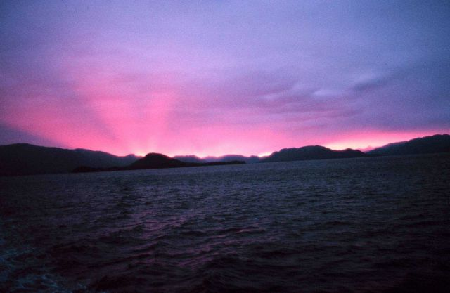Shadow bands in the pinkish glow of a Southeast Alaska sunset. Picture