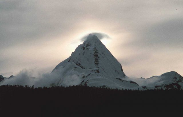 A sharp mountain peak with cloud formed by orographic lifting of the air Picture